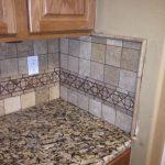 granite kitchen countertops with tile backsplash